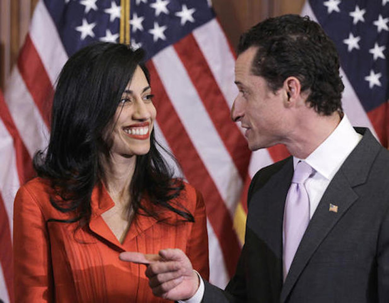 In this photo taken Jan. 5, 2011, then-New York Rep. Anthony Weiner and his wife, Huma Abedin, an aide to then-Secretary of State Hillary Clinton, are pictured after a ceremonial swearing in of the 112th Congress on Capitol Hill in Washington. Democratic presidential candidate Hillary Clinton aide Huma Abedin says she is separating from husband Anthony Weiner after another sexting revelation involving the former congressman from New York. (AP Photo/Charles Dharapak)